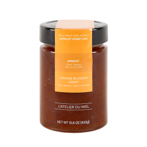Jar containing apricot raw honey jam